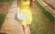 Yellow fit and flare dress from H&M online spring style Tiffany Pinero